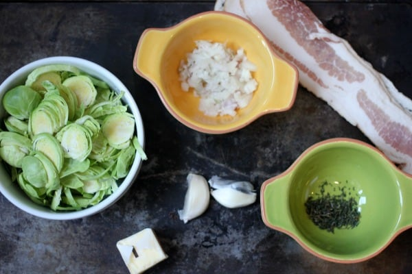 Ingredients measured out: onions, bacon, brussel sprouts, garlic, herbs and butter