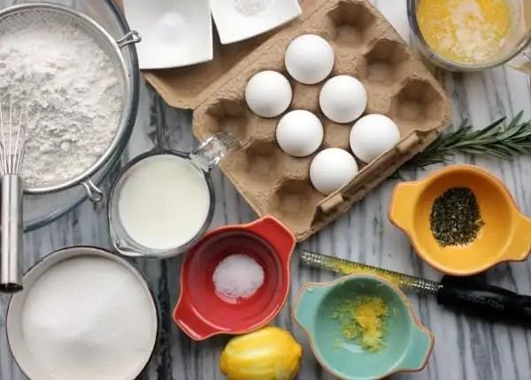 Fluffy Lemon-Rosemary Cake with Lemon Cream Cheese Frosting- Baker Bettie