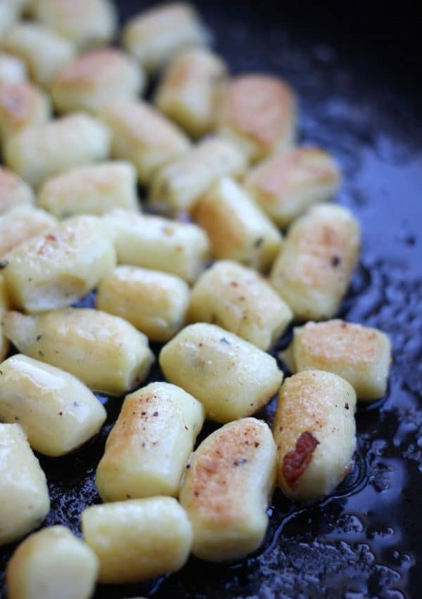 Pan frying the gnocchi until golden brown