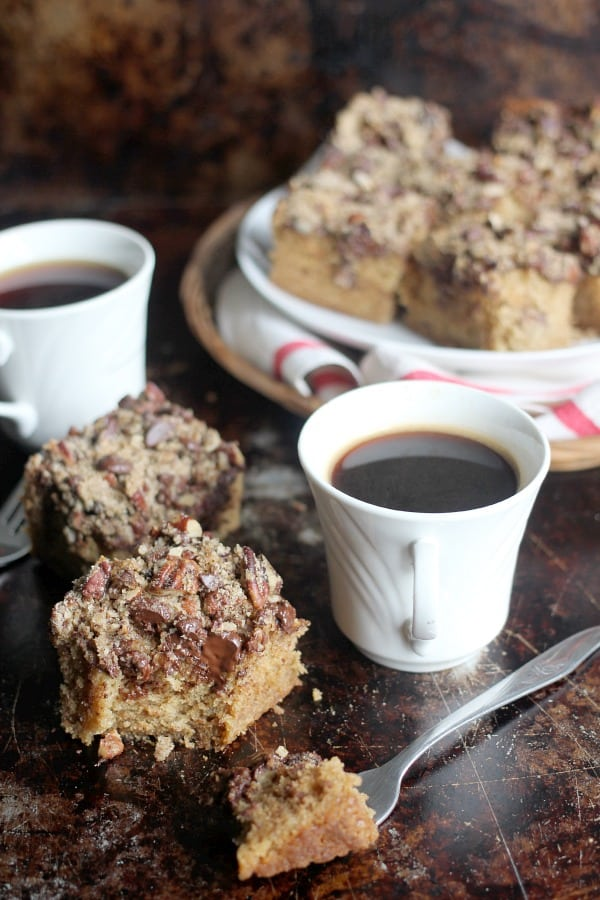 Espresso, Pecan, and Dark Chocolate Coffee Cake squares and a cup of coffee