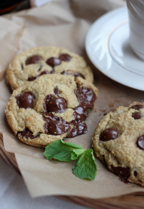 Chocolate chip cookies on a platter with a sprig of mint