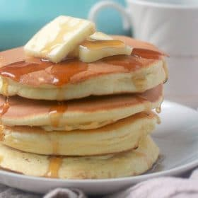 Stack of souffle pancakes with butter and maple syrup