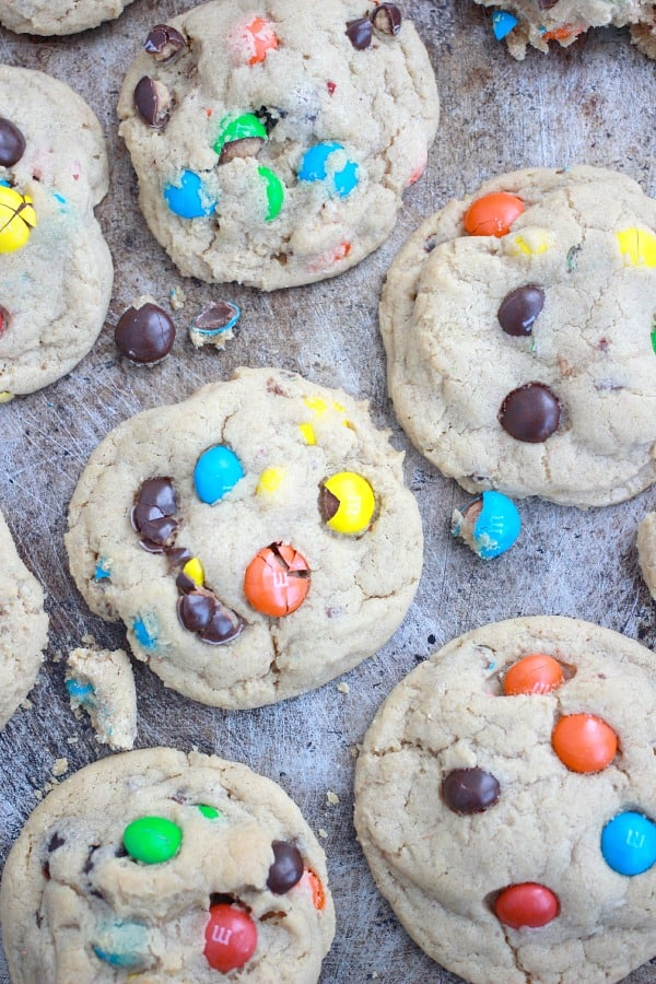 Thick and Soft Peanut Butter M&M Cookies on a sheet pan
