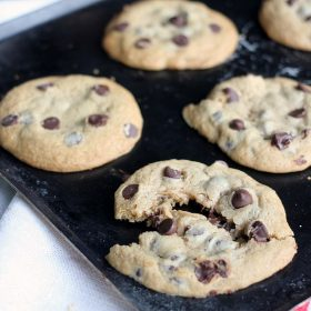 Soft and Chewy Chocolate Chip Cookies on a sheet pan