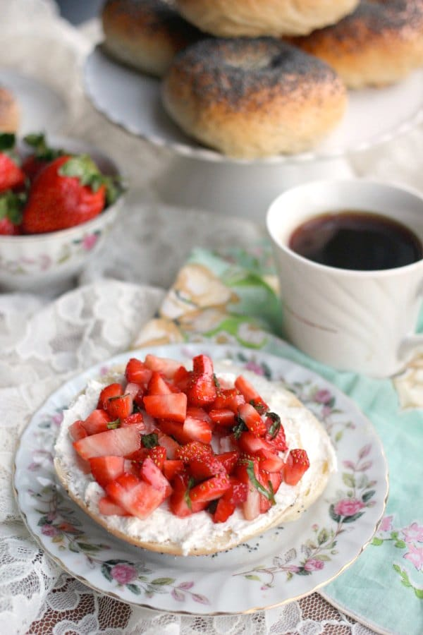 Bagel cut in half and topped with cream cheese and sliced strawberries