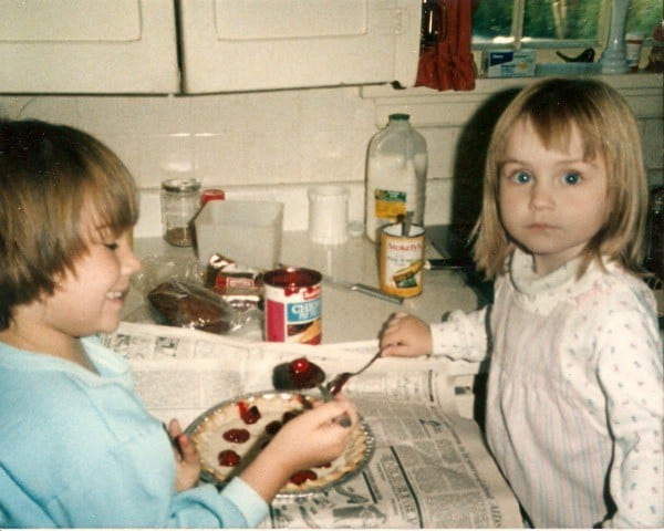 My sister Kelsey (left) and me (right) in our grandmother's kitchen making a cherry pie.