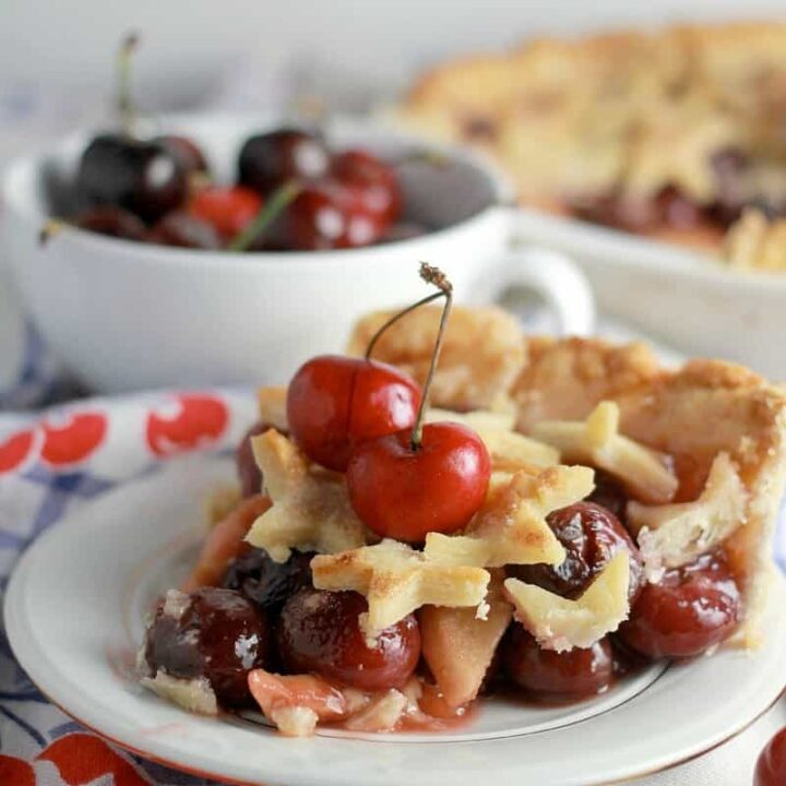 A slice of cherry apple pie