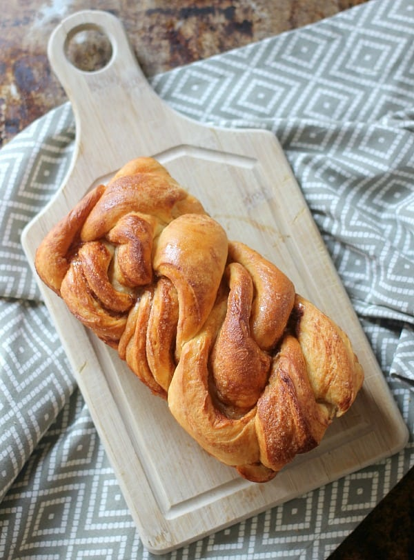 Braided Cinnamon Loaf on a cutting board