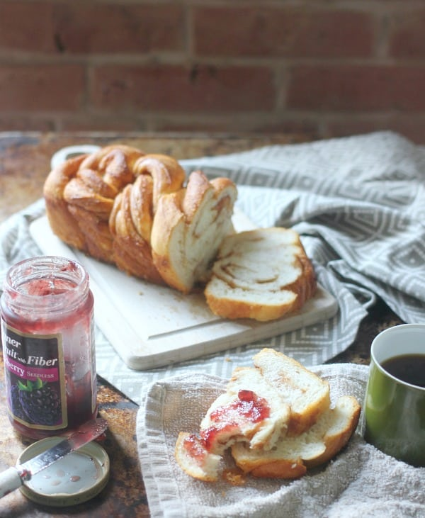 Braided Cinnamon Loaf sliced up with jam