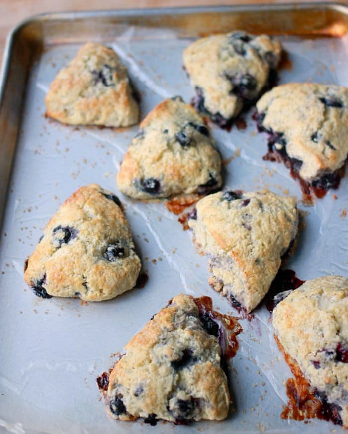 Blueberry scones after being baked on a sheet pan