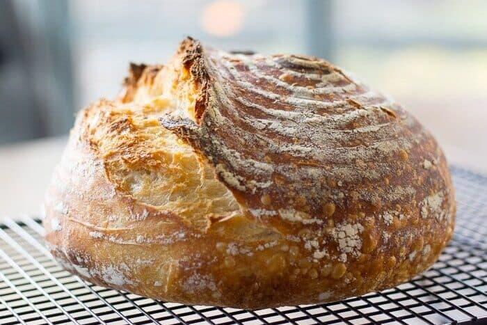 A beautiful, crust loaf of sourdough bread