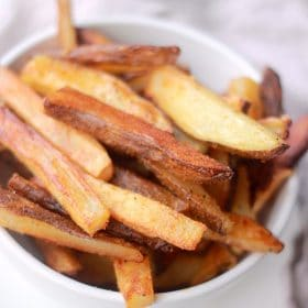 Crispy oven fries in a bowl