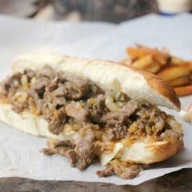 Philly Cheesesteak sandwich and fries