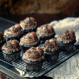 Peanut Butter Cup Stuffed Cupcakes on a wire rack