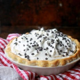 A Chocolate Cream Pie decorated with whipped cream and mini chocolate chips