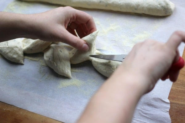 Cutting more wheat stalks into the dough