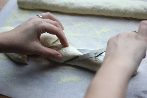 Cutting the wheat stalk shape into the bread dough with scissors