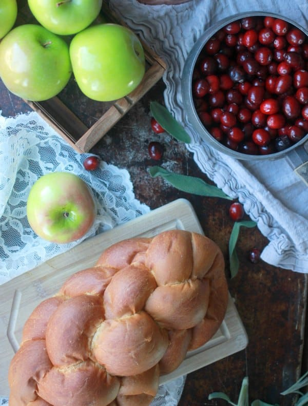 Challah bread, green apples and fresh cranberries spread out
