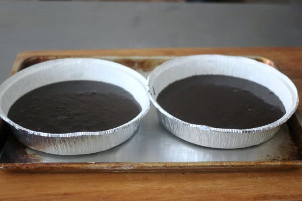 Raw cake batter poured into 2 round cake pans