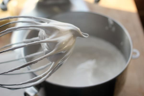 Meringue holding its shape off a whisk