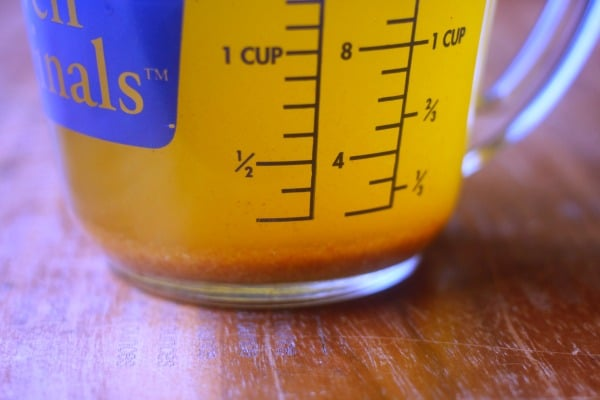 Browned butter in measuring cup