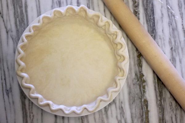 Pie crust crimped in pie tin