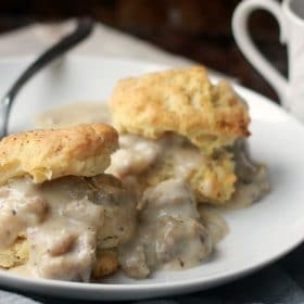 Plate of biscuits with sausage gravy
