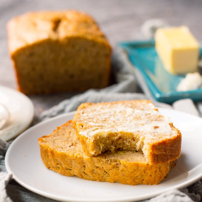 Sliced moist banana bread with butter