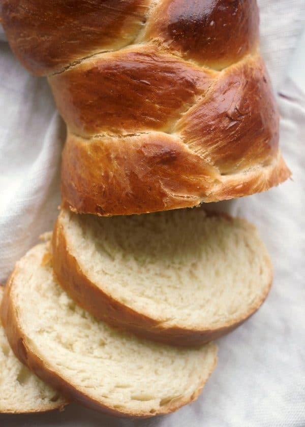 Three Braid Basic Challah Bread cut into slices