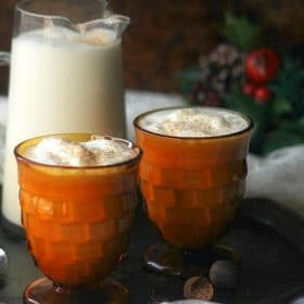 Eggnog in pretty glasses on a tray