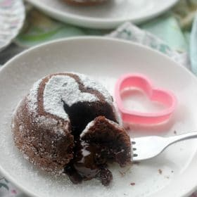 Heart shaped chocolate lava cake with gooey center oozing out