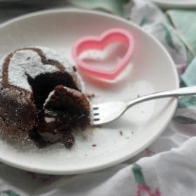 Molten Chocolate Lava Cake with bite taken out with a fork