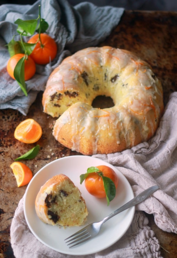 A slice of Tangerine Dark Chocolate Pound Cake with glaze