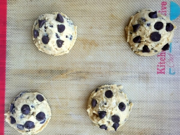 Chocolate Chip Cookie dough scooped onto a baking mat