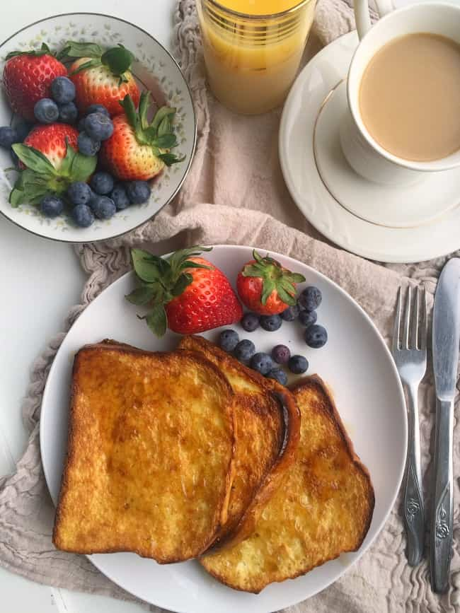 This method for perfect and easy french toast gives you a super crispy crust with a light and fluffy inside! The pan baked method allows for all of the french toast to be complete at the same time while preventing any of the toast from getting soggy!