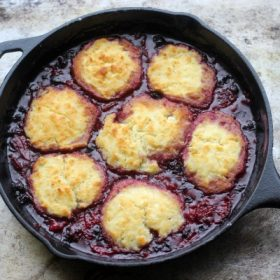 Triple Berry Cobbler in a cast iron skillet