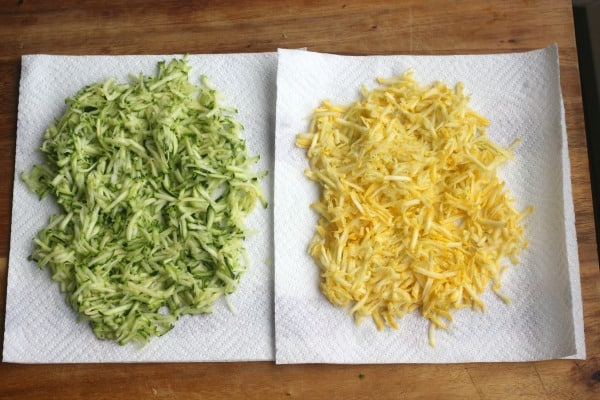 Green and yellow squash grated and being drained