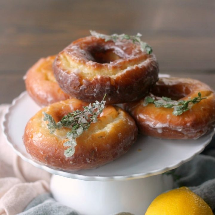 Lemon Thyme Old Fashioned Donuts on a cake stand