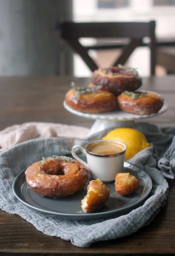 Lemon Thyme Old Fashioned Donuts on a plate with a cup of coffee