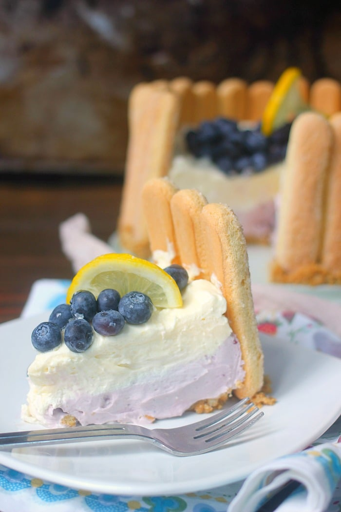A slice of Blueberry Lemon No-Bake Cheesecake on a plate