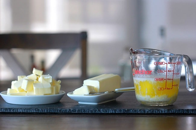 Cold butter, softened butter and melted butter in a cup