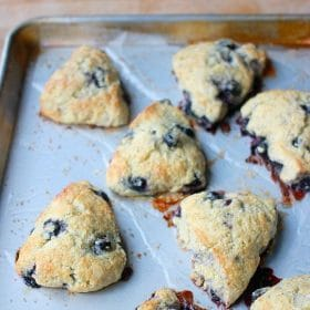 Blueberry scones on baking sheet