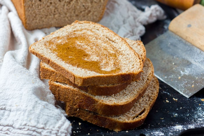 Slices of Honey Whole Wheat Bread drizzled with honey