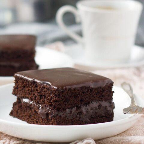Slices of layered chocolate sheet cake