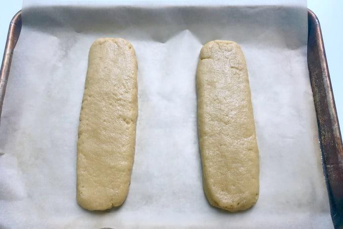 Shaping dough into logs on sheetpan
