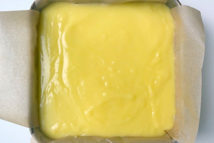 Lemon curd filling on top of the crust