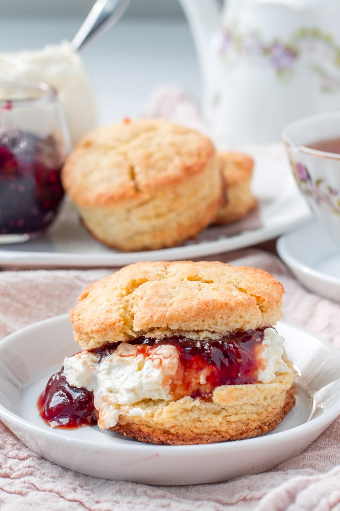 Scones topped with clotted cream and jam