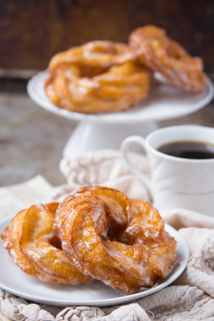 French cruller donuts dipped in powdered sugar glaze