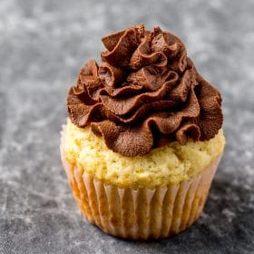 Whipped ganache topped over a cupcake