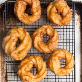 Crullers cooling on a wire rack